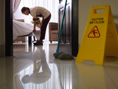 Florida hotel cleaning service with yellow caution sign